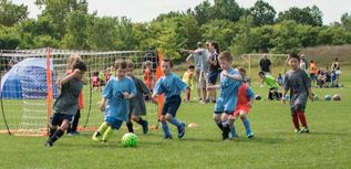 RSC Development League Boy Kicking Soccer Ball